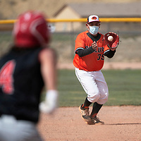 Gallup Bengal second baseman Josh Carl fields a grounder during their varsity baseball game against the Grants Pirates Tuesday afternoon in Gallup.