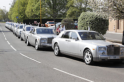 © Licensed to London News Pictures. 21/04/2018. Cobham, UK. A fleet of Silver Rolls Royces make up the cortege for the funeral of traveller 'Queenie, Elizabeth Doherty at Sacred Heart Church in Cobham, Surrey. Elizabeth Doherty, whose son Paddy Doherty is known for appearing on My Big Fat Gypsy Wedding and winning Celebrity Big Brother 8, died of a heart attack earlier this month. Paddy Doherty claimed his mother has died of a 'broken heart' following the death of her husband almost a year ago. Photo credit: Peter Macdiarmid/LNP