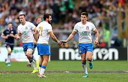 Italy's Tommaso Allan (right) celebrates after scoring a penalty kick during the NatWest 6 Nations match at the Stadio Olimpico, Rome.