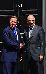 Prime Minister David Cameron (L) meets with Italian Prime Minster Enrico Letta at 10 Downing Street. <br /> Mr Letta is in the UK on a two day visit.<br /> 10 Downing Street, London, United Kingdom<br /> Wednesday, 17th July 2013<br /> Picture by Nils Jorgensen / i-Images
