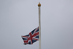 © Licensed to London News Pictures.10/04/2021. London, UK. The Union Flag flies at half mast above Buckingham Palace. Yesterday Buckingham Palace announced that Prince Philip The Duke of Edinburgh passed away in the morning at Windsor Castle . Photo credit: George Cracknell Wright/LNP