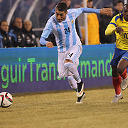 Roberto Pereyra, (left), Argentina, is challenged by Walter Ayovi, Ecuador, during the Argentina Vs Ecuador International friendly football match at MetLife Stadium, New Jersey. USA. 31st march 2015. Photo Tim Clayton