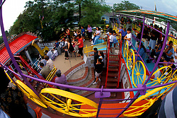 Stock photo of the view of the Orange Show from a colorful raised walkway
