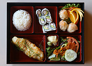 Bento Box clockwise from bottom left: Chilean Sea Bass, rice, California Roll, shumai and salad with ginger dressing. Monster Sushi is Morristown's newest restaurant specializing in sushi, sashimi, and other Japanese cuisine. Monster Sushi is located at 5 Pine St., Morristown, NJ. Tuesday, Oct. 21, 2015.  Special to NJ Press Media/Karen Mancinelli/Daily Record<br /> MOR 1028 TABLE Monster Sushi Morristown