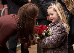 © Licensed to London News Pictures. 14/02/2012. Liverpool, UK. Aimee Haswell aged 7 presents a heart shaped posy of Roses to The Duchess of Cambridge on her visit to Alder Hey Hospital. Photo credit : Ashley Hugo/LNP
