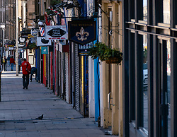 Row of closed shops and cafes on Leith Walk during coronavirus lockdown in Edinburgh, Scotland, UK