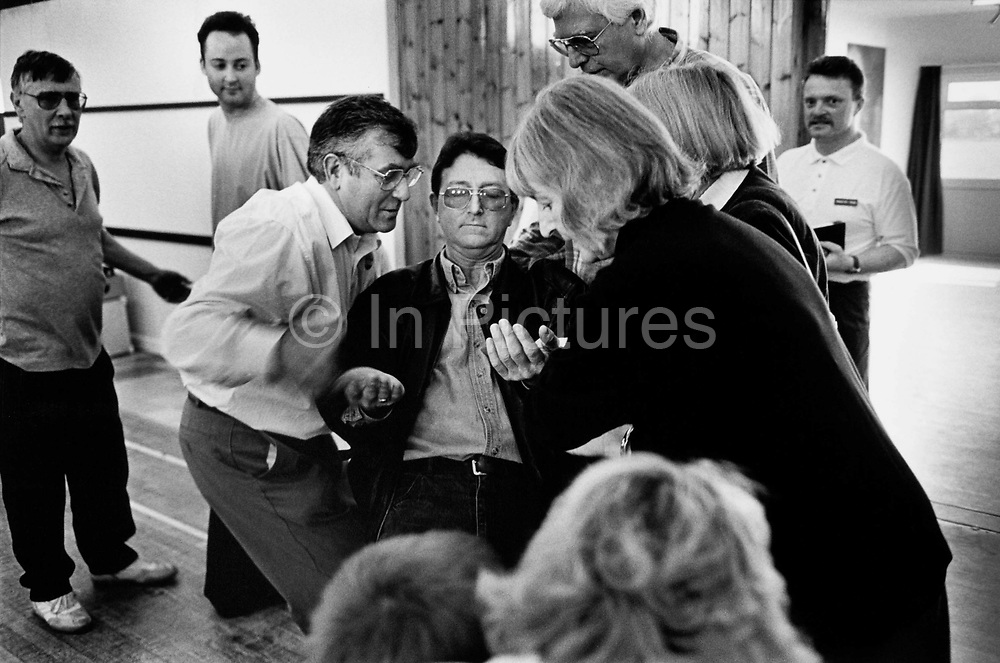 "The ""Fountain of Life"" evangelical congregation praying to be ""touched by the Holy Spirit. Norflok, UK. Anglican congregation present in the village that operates outside of the parish system but is still a member of the Church of England."