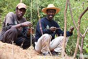 Madagascar, Analamanga region, two men at rest