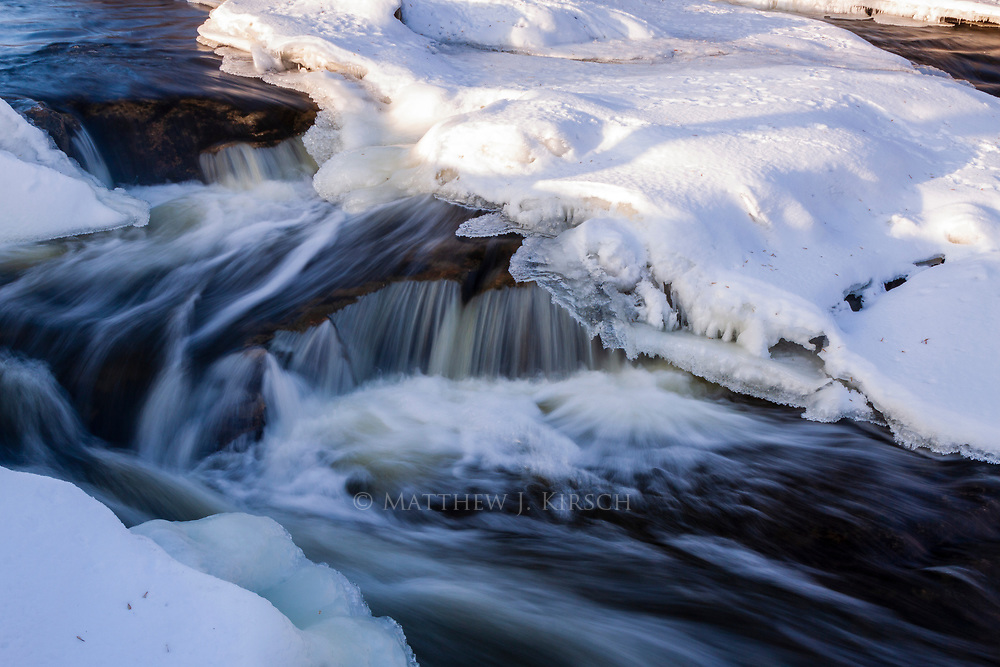 Cedar Creek within Cedarburg rarely freezes over due to the falls that drops 60 feet into the lower section of the creek.  Constant freeze thaw cycles make the behavior of this creek interesting.