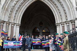 Royal Courts of Justice, London, February 8th 2017. As day two for the appeal hearing for 'Marine A' - Sgt Alex Blackman draws to a close, retired Marines and supporters gather on the steps of the High Court as his wife Claire emerges from the building. PICTURED: Marines wait for Sgt Blackman's wife Claire to emerge from the High Court.