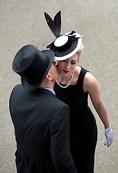© London News Pictures. 20/06/2013. Ascot, UK.  Two racegoers exchange a kiss at Ladies Day on day three of Royal Ascot at Ascot racecourse in Berkshire, on June 20, 2013.  The 5 day showcase event,  which is one of the highlights of the racing calendar, has been held at the famous Berkshire course since 1711 and tradition is a hallmark of the meeting. Top hats and tails remain compulsory in parts of the course. Photo credit should read: Ben Cawthra/LNP