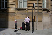 A businessman makes a quiet call in a side street in the Square Mile, on 3rd March 2017, in the City of London, England.