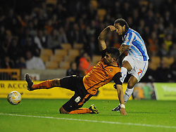 Huddersfield Town's Sean Scannell scores his sides second goal to make it 0 - 2 - Photo mandatory by-line: Dougie Allward/JMP - Mobile: 07966 386802 - 01/10/2014 - SPORT - Football - Wolverhampton - Molineux Stadium - Wolverhampton Wonderers v Huddersfield Town - Sky Bet Championship
