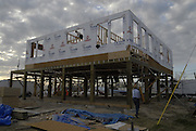 PICTURE THE DIFFERENCE rebuilding homes on the MS gulf coast. ( Photo©Suzi Altman) Volunteers from across America help rebuild Brian Mollere's home in Waveland after is was destroyed by Hurricane Katrina. Photo ©Suzi Altman