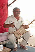 The rebab or rabab is the name of several related bowed string instruments that spread via Islamic trading routes over much of North Africa, Southeast Asia, the Middle East, and parts of Europe. Photographed in The Judea Desert, Israel / Palestinian Territories