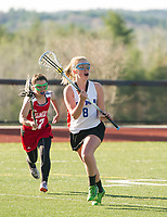 Belmont's Emily Vachon keeps pressure on Interlakes Moultonboro's Katie Gallagher as she looks for a pass during NHIAA Division III girls Lacrosse Tuesday afternoon.  (Karen Bobotas/for the Laconia Daily Sun)