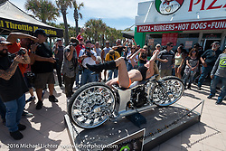 Kristi Verhoff poses with bikes at the 27th Annual Boardwalk Bike Show during Daytona Bike Week 75th Anniversary event. FL, USA. Friday March 11, 2016.  Photography ©2016 Michael Lichter.