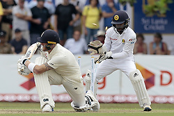 November 6, 2018 - Galle, Sri Lanka - England cricketer Ben Stokes is bowled out as Sri Lankan wicket keeper Niroshan Dickwella looks on during the  1st day's play  of the first test cricket match between Sri Lanka and England at Galle International cricket stadium, Galle, Sri Lanka on November 6, 2018. (Credit Image: © Tharaka Basnayaka/NurPhoto via ZUMA Press)
