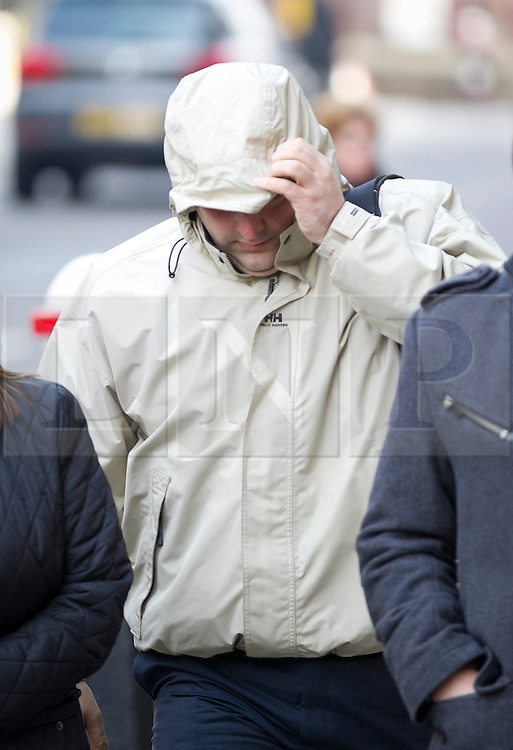 © Licensed to London News Pictures. 27/03/2013. London, UK. Ex-prison officer Richard Trunkfield, who pleaded guilty to misconduct in public office after admitting selling information about high profile prisoners to the Sun newspaper, covers his face as he arrives at the Old Bailey In London today (27/03/2013). Photo credit: Matt Cetti-Roberts/LNP