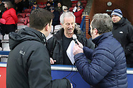 Interviewing fan during the EFL Sky Bet League 1 match between AFC Wimbledon and Barnsley at the Cherry Red Records Stadium, Kingston, England on 19 January 2019.