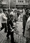 C012-12_Tom Hutchins_Girl with model aeroplanes to sell  in Wang Fu Chin, Peking, China 1956 A2.tif