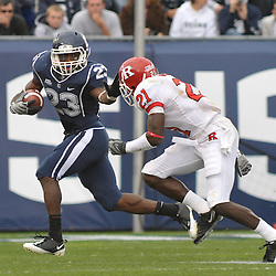 Oct 31, 2009; East Hartford, CT, USA; Connecticut running back Jordan Todman (23) stiff-arms Rutgers cornerback Devin Mccourty on a kickoff return during second half Big East NCAA football action in Rutgers' 28-24 victory over Connecticut at Rentschler Field.