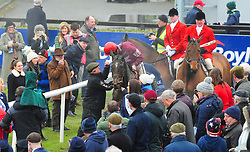 Jockey J J Slevin on board General Principle, celebrates with Uncle Jim O'Brien, watched by cousins Joseph (on left) and Sara o'Brien (white cap) after winning the Boylesports Irish Grand National Chase, during BoyleSports Irish Grand National Day of the 2018 Easter Festival at Fairyhouse Racecourse, Ratoath, Co. Meath.