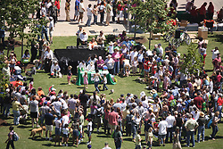 Stock photo of many people gathered for a dog show in the park