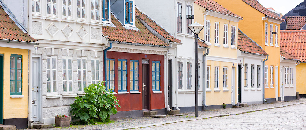Painted houses in Ramsherred cobbled street in old town in Odense on Funen Island, Denmark