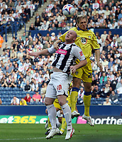 Photo: Rich Eaton.<br /> <br /> West Bromwich Albion v Leeds United. Coca Cola Championship. 30/09/2006. John Hartson left of West Brom and Matthew Kilgallon of Leeds go for a header