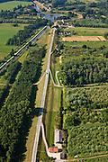 Nederland, Zuid-Holland, Gemeente Leerdam, 08-07-2010; Diefdijk tussen Leerdam en Schoonrewoerd. De dijk maakt onderdeel uit van Nieuwe Hollandse Waterlinie en omdat de dijk doorsneden wordt door de spoorlijn Leerdam-Geldermalsen is er een fort gebouwd (naam Werk op de spoorweg, boven in beeld). De Diefdijk is verder een binnendijk en oorspronkelijk aangelegd om de Alblasserwaard en de Vijfherenlanden tegen wateroverlast uit de Betuwe te beschermen. .Diefdijk. The inner dike was originally built to protect the polders Alblasserwaard and Vijfherenlanden against flooding from the Betuwe. In addition, the dike is part of the New Dutch Waterline, hence the fortress which protects the 'breach' made by the railway (top)..luchtfoto (toeslag), aerial photo (additional fee required).foto/photo Siebe Swart