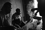 """NAIROBI, KENYA - AUGUST 16, 2011: After an hour of excercise each morning, Kamau """"Kelly"""" Ng'ang'a, 21, eats a regular a breakfast of red beans, chapati and chai tea at a local restaurant in Kibera.<br /> <br /> Within Kenya's progressive youth culture is the Kibera Olympic Boxing Club, a group of low-income adolescents from the slum whose leader uses boxing as a way to engage with idle youth. The group's ethnic diversity is remarkable given Kenya's 2008 post-election violence in which people from several tribes were forced violently out of slums. Together, these boxers represent a nascent trend of cross-tribe brotherhood in a healing nation."""