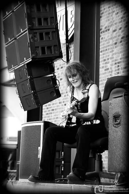 Sue DaBaco live at Summerfest 2010. Photo © Jennifer Rondinelli Reilly. All rights reserved. No use without permission. Contact me for any reuse or licensing inquiries.