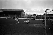 20/03/1963<br /> 03/20/1963<br /> 20 March 1963<br /> Soccer: Transport v Limerick, Cup tie replay at Harold's Cross, Dublin. Limerick goalie, Prendergast, beaten by Bennett of Transport for the first goal of the match.