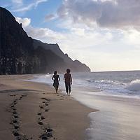Kalalau Beach, Napali Coast, Kauai, couple walking west down beach