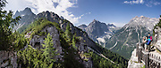 A short, steep walk from Rotwand lift takes you to an impressive overlook of Val Fiscalina (Fischleintal) and Croda Rossa di Sesto peak, also known as Cima Dieci and Sextener Rotwand (left, 9728 feet/2965 meters). From Bagni di Moso near Sesto in Val Pusteria (Pustertal), take the Rotwand lift (gondola) to Prati di Croda Rossa meadows for scenic walks in the Sesto Dolomites (Dolomiti di Sesto / Sexten / Sextner / Sextener Dolomiten). A short way up trail #100 offers a good overlook of Val Fiscalina (Fischleintal), in Trentino-Alto Adige/Südtirol (South Tyrol), Italy. The Dolomites are part of the Southern Limestone Alps, Europe. UNESCO honored the Dolomites as a natural World Heritage Site in 2009. This panorama was stitched from 6 overlapping photos.