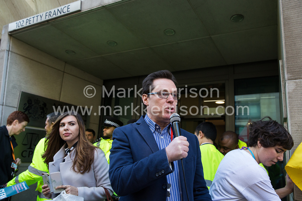 London, UK. 26th February, 2019. Austin Harney from the National Executive Committee of the Public and Commercial Services Union (PCS) addresses mainly migrant striking outsourced workers belonging to the Independent Workers of Great Britain (IWGB), United Voices of the World (UVW) and PCS trade unions working at the University of London (IWGB), Ministry of Justice (UVW) and Department for Business Energy and Industrial Strategy (PCS), together with representatives of the National Union of Rail, Maritime and Transport Workers (RMT) Regional Council, taking part in a 'Clean Up Outsourcing' demonstration to call for an end to the practice of outsourcing. The demonstration was organised to coincide with a significant High Court hearing of an application by the IWGB for judicial review of a decision by the Central Arbitration Committee (CAC) not to hear their application for trade union recognition for the purposes of collective bargaining with the University of London.