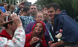 Team Great Britain's Jonathan Brownlee poses for a picture with fans after the 2018 Accenture World Triathlon Mixed Relay Event in Nottingham.