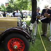 Judges compare notes at the Greenwich Concours d'Elegance Festival of Speed and Style featuring great classic vintage cars. Roger Sherman Baldwin Park, Greenwich, Connecticut, USA.  2nd June 2012. Photo Tim Clayton