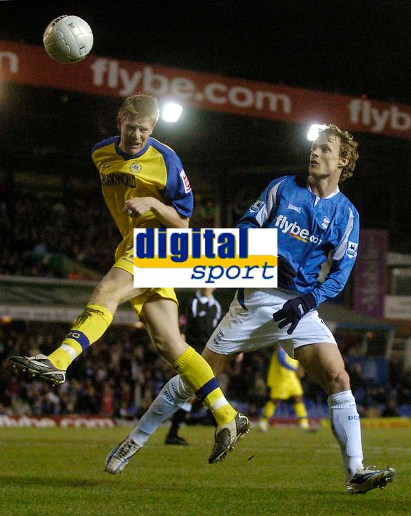 Photo: Glyn Thomas.<br />Birmingham City v Torquay United. The FA Cup. 17/01/2006.<br />Birmingham's Jiri Jarosik (R) and Torquay's Adam Lockwood look to gain the upper hand.