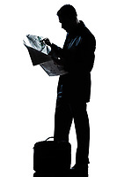 one caucasian man standing reading newspaper  full length silhouette in studio isolated white background