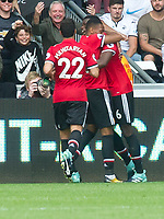 Football - 2017 / 2018 Premier League - Swansea City vs. Manchester United<br /> <br /> Rear view as Anthony Martial of Manchester Utd celebrates scoring his team's 4th goal with Paul Pogba-their 3rd within 4 minutes, at the end of the game <br /> , at Liberty Stadium.<br /> <br /> COLORSPORT/WINSTON BYNORTH