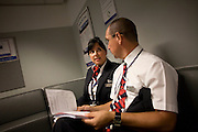 Cabin crew are briefed before a flight in the British Airways Crew Report Centre at Heathrow Airport's Terminal 5.