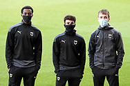 AFC Wimbledon defender Huseyin Biler (32), AFC Wimbledon attacker Zach Robinson (14) and AFC Wimbledon player Jack Currie during the EFL Sky Bet League 1 match between AFC Wimbledon and Lincoln City at Plough Lane, London, United Kingdom on 2 January 2021.