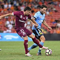 BRISBANE, AUSTRALIA - FEBRUARY 3: Joshua Brillante of Sydney is tackled by Dimitri Petratos of the Roar during the round 18 Hyundai A-League match between the Brisbane Roar and Sydney FC at Suncorp Stadium on February 3, 2017 in Brisbane, Australia. (Photo by Patrick Kearney/Brisbane Roar)