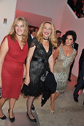 Left to right, TRACEY EMIN, JERRY HALL and NANCY DELL'OLIO at a dinner in aid The Journalism Foundation held at Philips De Pury & Company, Howick Place, London, SW1 on 22nd May 2012.
