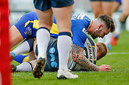 Doncaster RLFC scrum half Jordan Howden (6) tackles Featherstone Rovers interchange Keal Carlile (9)  during the Challenge Cup 2018 match between Doncaster and Featherstone Rovers at the Keepmoat Stadium, Doncaster, England on 22 April 2018. Picture by Simon Davies.