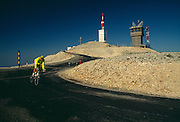 France, Provence, summit of Mount Ventoux, bicyclist riding on road