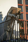 Sculpture of photographer with old-fashioned camera on balcony, Ronda, Andalusia, Spain