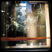 A smashed window of a shop on Ermou Street. <br /> <br /> Following the murder of a 15 year old boy, Alexandros Grigoropoulos, by a policeman on 6 December 2008 widespread riots, protests and unrest followed lasting for several weeks and spreading beyond the capital and even overseas<br /> <br /> When I walked in the streets of my town the day after the riots I instantly forgot the image I had about Athens, that of a bustling, peaceful, energetic metropolis and in my mind came the old photographs from WWII, the civil war and the students uprising against the dictatorship. <br /> <br /> Thus I decided not to turn my digital camera straight to the destroyed buildings but to photograph through an old camera that worked as a filter, a barrier between me and the city.